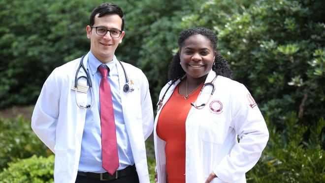 Medical students Gabe Lowenhaar and Harielle Deshommes put their language translating talents to work in Immokalee.