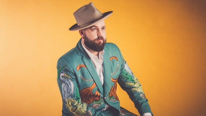 Fiddle player and singer Joshua Hedley, a Collier County native, makes his Grand Ole Opry debut in Nashville on Friday, April 20, 2018, in his custom-made Florida-themed rhinestone suit.