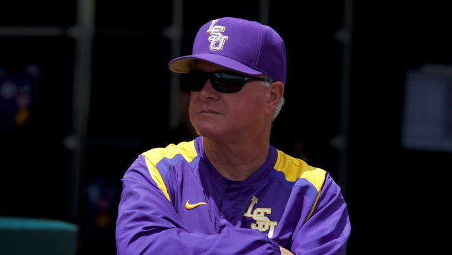 LSU Tigers head coach Paul Mainieri looks out from the dugout.