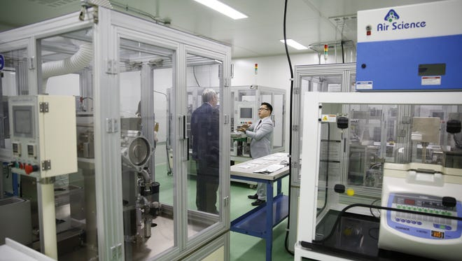Director of business Development Jonathan Shih leads a tour of General Capacitor's new dry room Monday. The new facility will be used for manufacturing and R&D using lithium, a metal that is extremely sensitive to moisture.