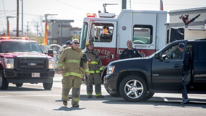 Emergency crews block off a section of West McGalliard Road between Walnut and Reserve Streets Thursday morning for a gas leak near the Crew Car Wash. The road was closed for nearly five hours.