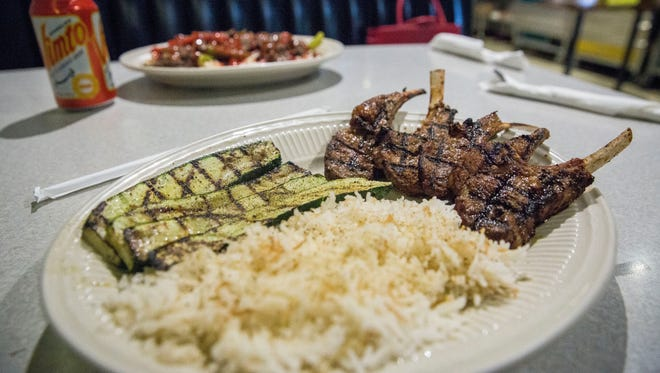 Grilled lamb, zucchini and rice are one of several main dinners available on Maadi Grill's menu at their White River Boulevard location. The owners new downtown location inside the Rose Court will have the same Egyptian-American flavor but cater to a quicker breakfast and lunch crowd.