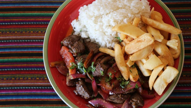 Lomo saltado ($12) -- beef tenderloin, onions and tomatoes stir-fried with soy sauce and the South American chile aji Amarillo -- from Culantro, a new Peruvian restaurant in Ferndale.