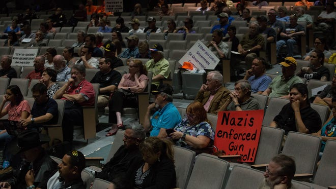 Residents attend a joint work session between Las Cruces Public Schools and Las Cruces City Council, where the boards discussed school safety and a proposed resolution asking the state to restrict certain types of firearms Wednesday, May 2, 2018. Many in the Oñate High School theater were there to protest the resolution.