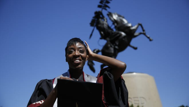 Margarette Swift poses in front of the Unconquered statue Wednesday ahead of Friday's commencement ceremony. Swift will graduate from Florida State with a hard-earned degree in Social work.