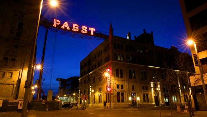 The sun sets behind the neon Pabst sign at the Pabst Brewing Company complex on West  Juneau Ave in Milwaukee on Sunday, May 6, 2018.