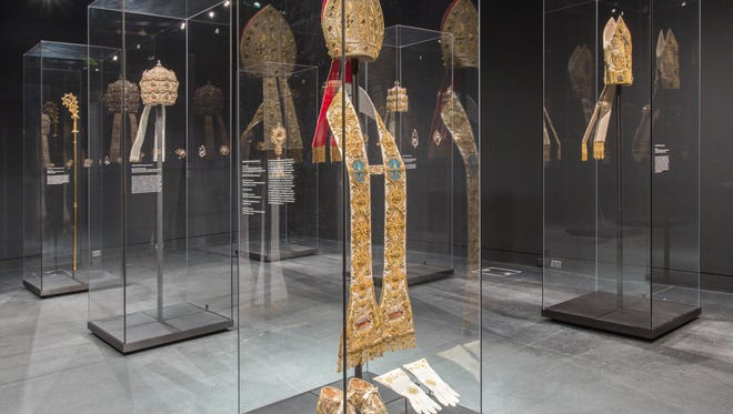 Garments from the Vatican on display at the Carl and Iris Barrel Apfel Gallery.