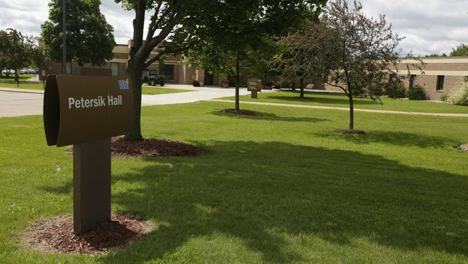 A sign identifies Petersik Hall outside the Winnebago Mental Health Institute in Oshkosh, where inspectors found that two minors were housed with adults without proper supervision.