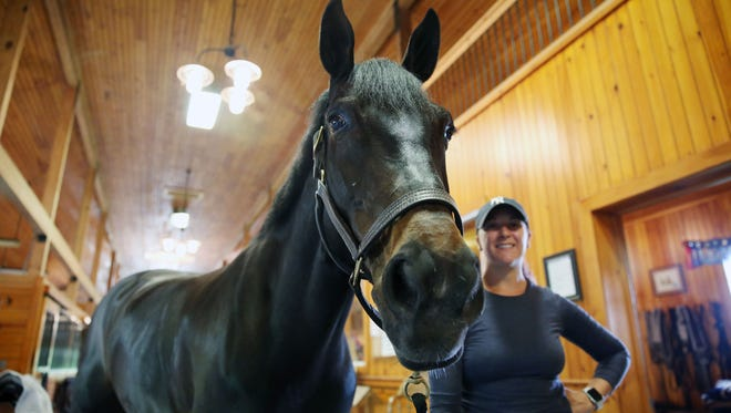 """Horse owners and trainers walk in the barn at Pavillion Farm in North Salem May, 10, 2018. An Airbnb-inspired online market place called """"Staller"""" has expanded into Westchester, and farm owners are able to make some extra money."""