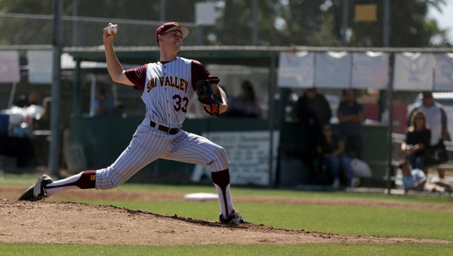 Simi Valley ace Owen Sharts fires a pitch during Thursday's playoff game against St. Bonaventure. The Pioneers lost, 1-0, in a tense first-round matchup.