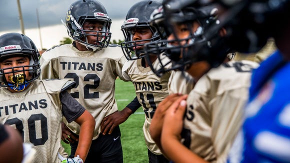 The Golden Gate Youth Titan Football team practices at Golden Gate High School on Thursday, May 17, 2018.