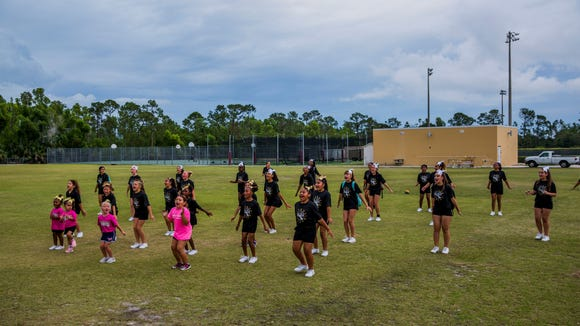 The Golden Gate Youth Titan Cheerleaders practice at Golden Gate High School on Thursday, May 17, 2018.
