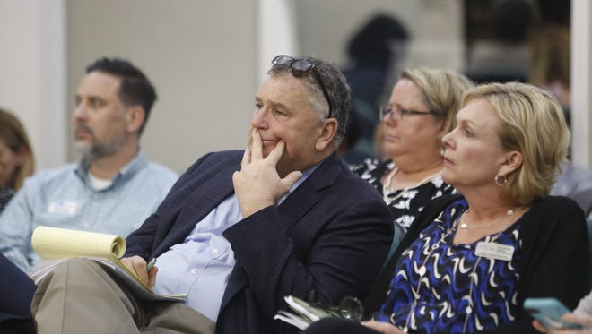 Jon Moyle, Tallahassee attorney and chairman of the Our Kids First political action committee, was among those listening at the Leon County Commission meeting.