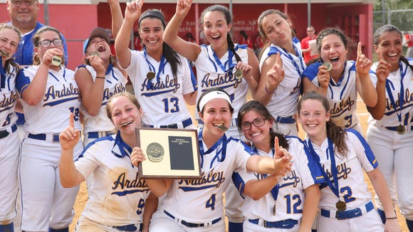 Sarah Rende (top, third from left) and Lauren Rende (bottom, far left) celebrate with their Ardsley teammates after defeating Tappan Zee to win the Section 1 championship game at North Rockland High School on May 26, 2018.