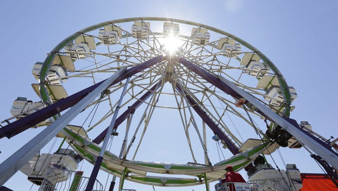 People ride on a Ferris wheel Friday during the Lincoln County Fair in Merrill in 2016.