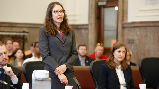 Alice Clapman with Planned Parenthood Federation of America speaks to the judge as Rita Bettis with the ACLU of Iowa looks on Friday, June 1, 2018, during a hearing over Iowa's 'fetal heartbeat' abortion law at the Polk County Courthouse in Des Moines