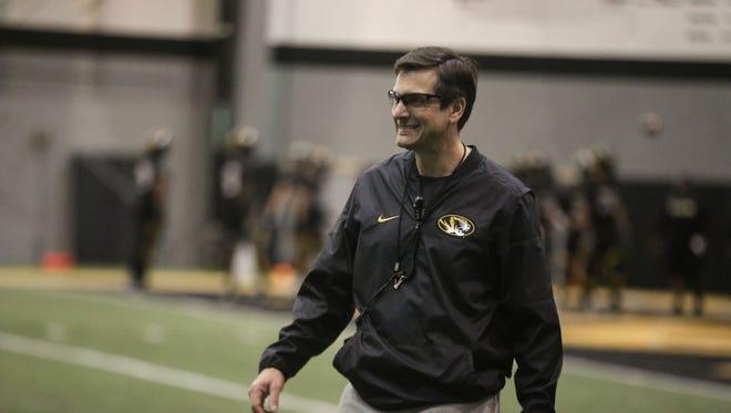 Missouri offensive coordinator Derek Dooley coaches at spring practice in Columbia, Mo.