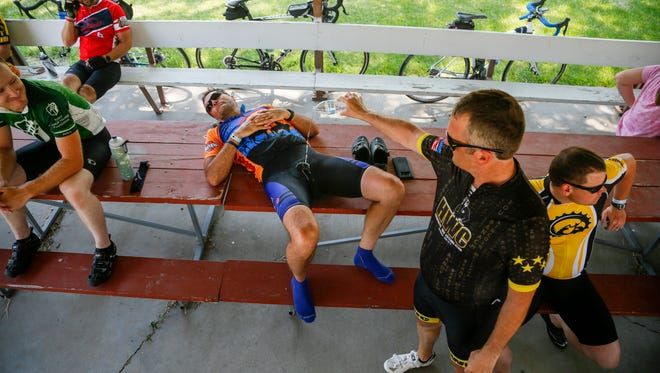 Josh Schamberger pours water on Tory Kelsay during a rest stop in Riverside on day six of the 2018 RAGBRAI Pre-Ride Route Inspection Friday, June 8, 2018.