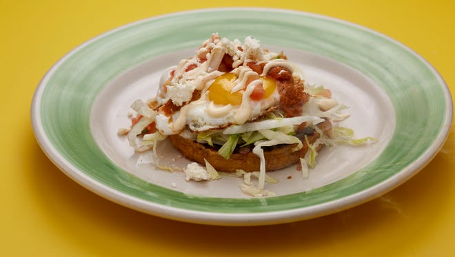 One of the dishes at the new brunch at Snifters Tapas & Spirits, 606 S. 5th St., is a sope topped with refried beans, a fried egg and avocado. Brunch is 9 a.m. to 2 p.m. Saturdays and Sundays.