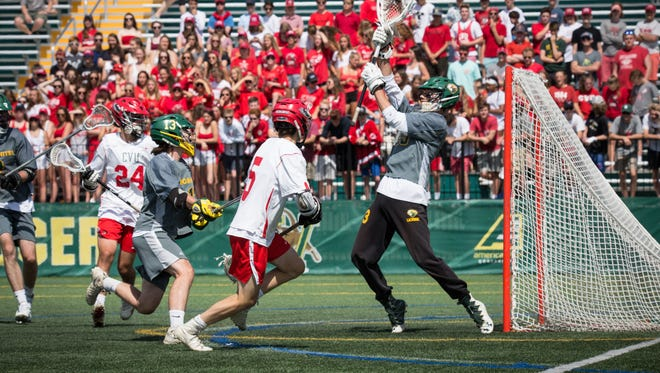 Jake Schaefer of CVU scores during Saturday's Division I boys lacrosse final.