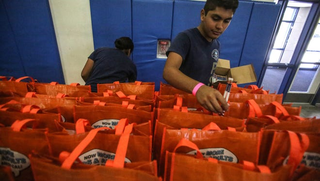 Aaron Abina, 16, a Desert Hot Springs High student, assembles handout emergency kits at the Earthquake & Emergency Preparedness Seminar at Desert Hot Springs High School on Saturday, June 9, 2018, in Desert Hot Springs.