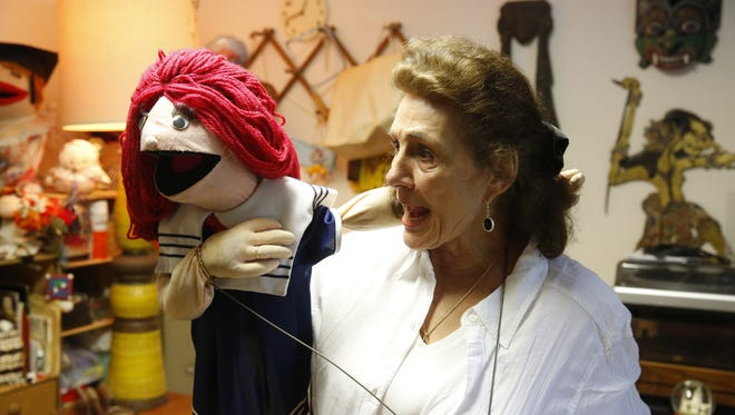 Jan Kaufman showcases one of her many puppets. Jan has been a puppeteer since the age of 14 and has performed all around the world.