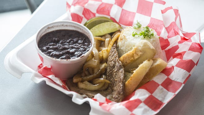 Bistec encebollado, a Cuban style marinated steak, is a delicacy of the Latin American country's cuisine. It is served with the Cuban staple black beans and rice.