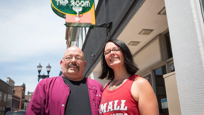 Keith Martz and Natasha Martz stand in front of their bar the Mark III Tap Room, one of Indiana's oldest gay bars. The downtown business will celebrate 50 years on Saturday.