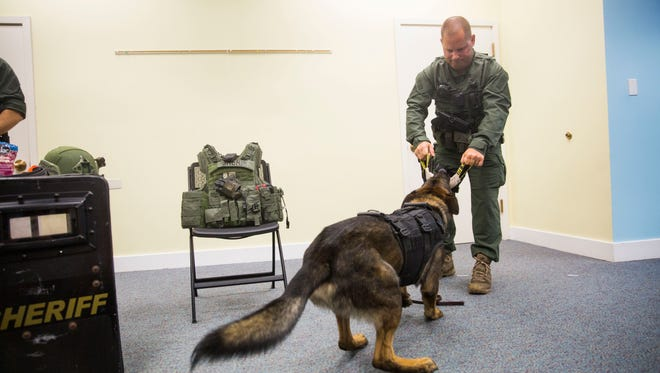Corporal Thomas Sweeney plays with Rexo during a K-9 demonstration at the Collier County Library - Estateson Thursday, June 21, 2018 at the Collier County Library in Golden Gate Estates.