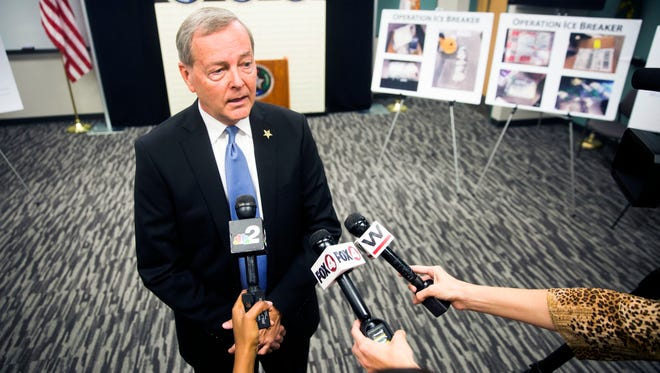 Sheriff Kevin Rambosk answers questions from the press during a press conference on Friday, June 22, 2018 at the Collier County Sheriff's Office Aviation Bureau. The Collier County Sheriff's Office and other law enforcement partners ended a yearlong methamphetamine trafficking investigation Thursday.