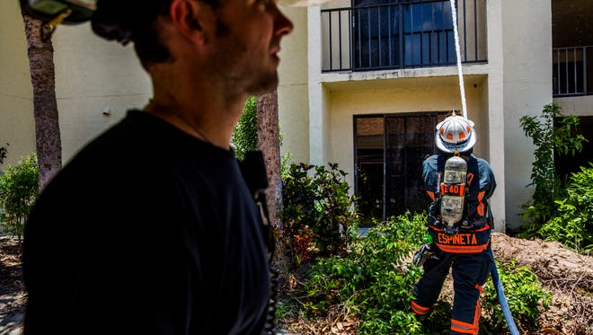 North Collier Fire and Rescue conducts training at the Vi at Bentley Village in North Naples on Friday, June 22, 2018. The Vi at Bentley Village volunteers their vacant structures for fire and rescue training before demolition of the buildings.