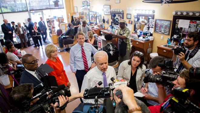 Joe Biden, former Vice President, speaks to members of the media at Beyond Image Barber Salon in Camp Washington on Friday June 29, 2018.