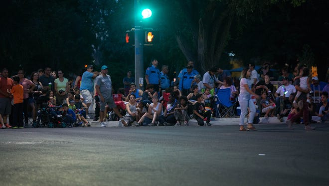 Las Cruces residents line South Solano Drive to watch the 2018 Electric Light Parade, Tuesday July 3, 2018.