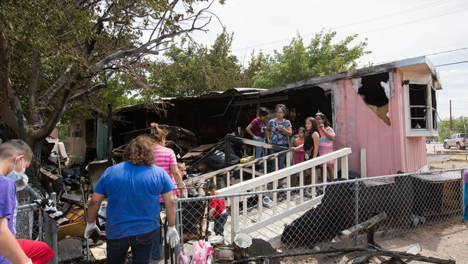 The Ochoa family spent most of the day searching and cleaning up the burned remains of Zenaida Ochoa's mobile home, Thursday July 5, 2018. The fire was reported around 10 p.m. Wednesday evening.