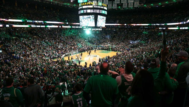 Boston Celtics fans cheer after a made three-pointer against the Bucks during Game 1 of the first round of the 2018 NBA Playoffs at TD Garden. Mandatory Credit: Paul Rutherford-USA TODAY Sports