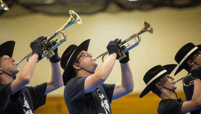Winchester's marching band competes in the Spirit of Sound marching band contest Saturday evening inside Central's gym. The band performances were moved inside due to weather, causing delays in both the performance schedule and the ability for the bands to march their shows.