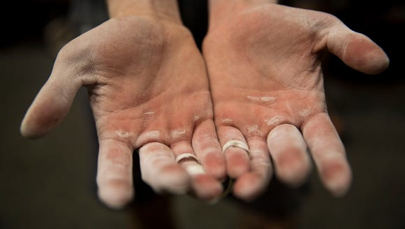 Alan Kellingley reveals his calloused hands after attempting