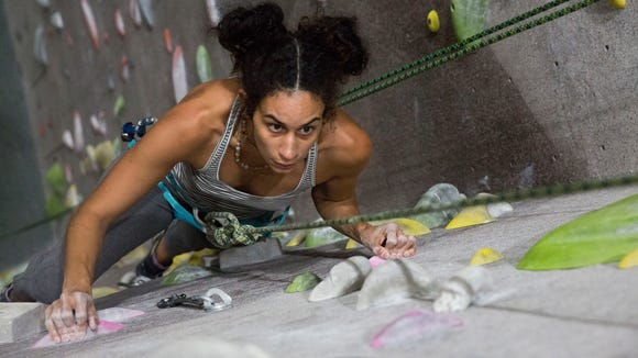 Aisha Saleh ascends a top rope climb, at projectROCK in Oakland Park, Florida on Tuesday, July 17, 2018. Each route is graded by level of difficulty.
