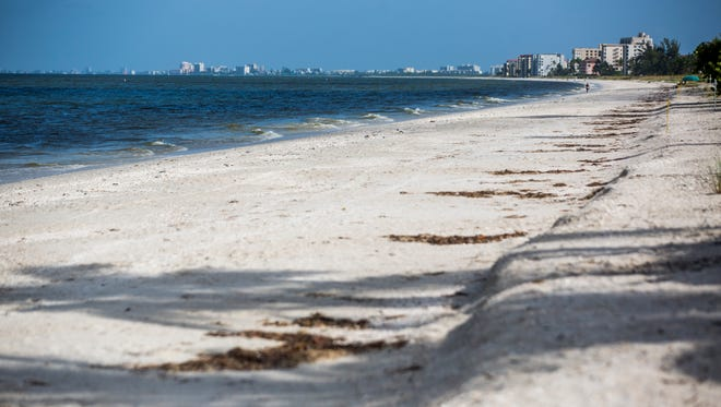 A nearly empty Bonita Beach on Wednesday, Aug. 1, 2018. The red tide bloom has been leaving dead fish along the shoreline and making the air difficult to breathe.
