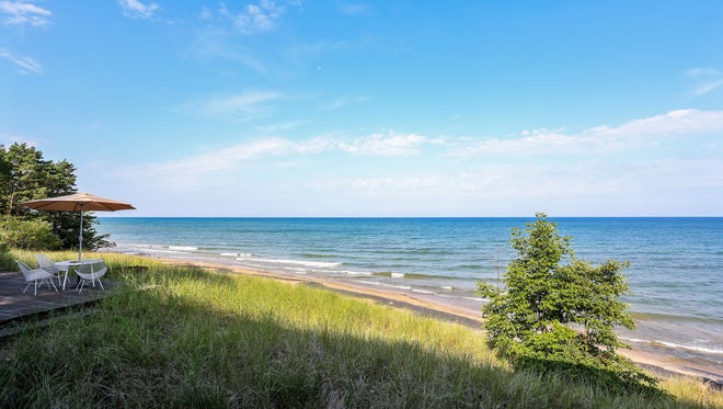 The Blue Star Highway home on Lake Michigan has a detached Coach House with kitchenette,full bath and private deck. The property also has a Hot Tub Pavilion.