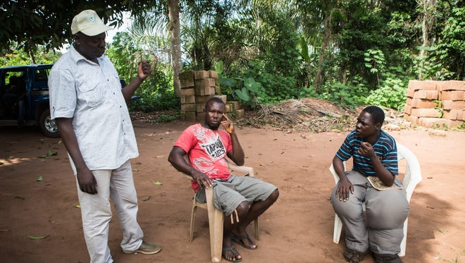 Emmanuel Mmadu has severe swelling in both legs from lymphatic filariasis. Dr. Adamu Keana Sallau talks to community members in a Nigerian village about efforts to cure and prevent elephantiasis.