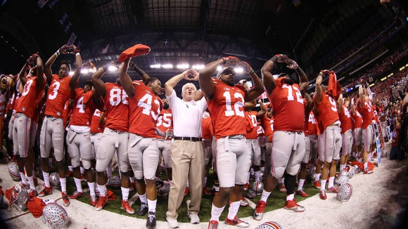 Ohio State Buckeyes celebrate after defeating the Wisconsin Badgers in the Big Ten Football Championship game at Lucas Oil Stadium in Indianapolis on Saturday.