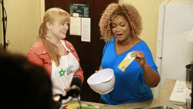 """Megan Huffman with Food Network personality, Sunny Anderson, at the Extended Stay America """"Away from Home Cooking Recipe Contest."""""""
