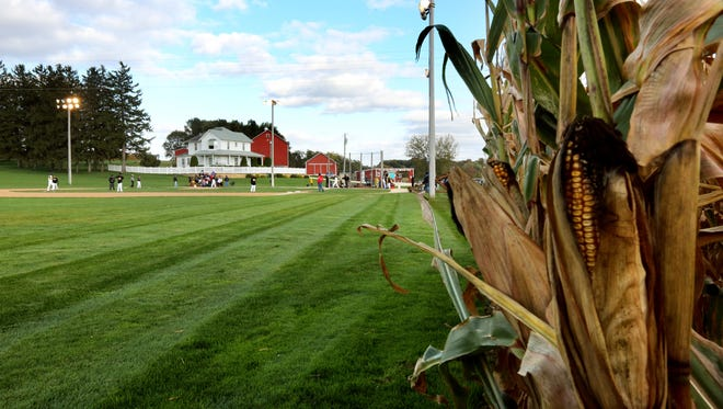 FILE - In this Oct. 4, 2014 file photo, players take the field at the Field of Dreams in Dyersville, Iowa, during a fall baseball tournament. The Dubuque Telegraph Herald reports a group of nearby property owners filed a lawsuit two years ago after the Dyersville City Council decided to rezone the property from agricultural to commercial use. (AP Photo/The Telegraph Herald, Dave Kettering, file)