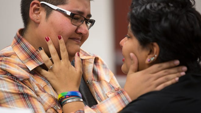 Erika Alvarez cries with Abby Ortiz as Judge Howard Grodman marries them in Arizona at the Coconino County Courthouse in Flagstaff, AZ on Friday, Oct. 17, 2014.