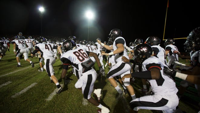 Williams Field enters the field before a game against Saguaro at Scottsdale Saguaro on Thursday, Oct. 9, 2014.