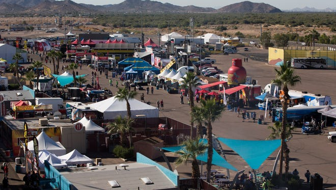 A light crowd shows up in the afternoon before the truck race that night at Phoenix International Raceway in Avondale, AZ on Friday, Nov. 7, 2014.