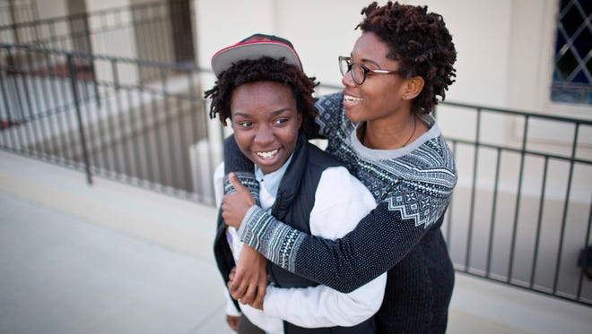 Shanté Wolfe, left and Tori Sisson embrace near the Montgomery County Courthouse, Sunday, Jan. 25, 2015, in Montgomery, Ala., where they plan to stay overnight to be married Monday morning.