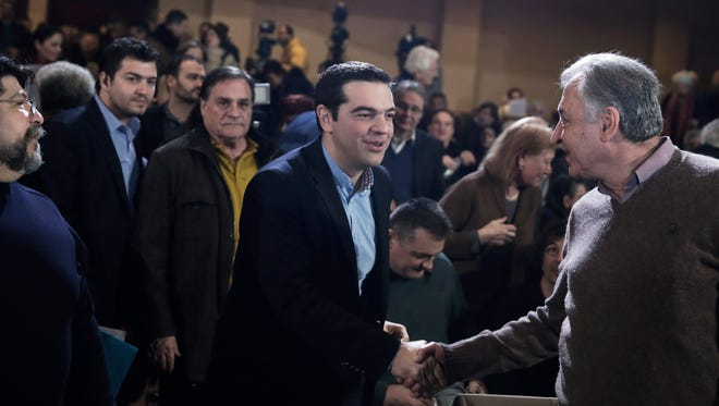 Greek Prime Minister and Syriza leader Alexis Tsipras, centre, arrives at his party central committee, in Athens, on Saturday, Feb. 28, 2015.