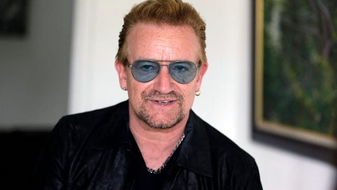 "Irish rock star Bono speaks during an interview with The Associated Press in Lagos, Nigeria on Aug. 28, 2015. Bono is a launching an all-star campaign featuring ""once-in-a-lifetime experiences"" that can be won after donating at least $10 to his organization (RED), which raises funds to fight AIDS. The campaign kicks off Tuesday, Dec. 1, 2015, to coincide with World AIDS Day, which is Dec. 1."